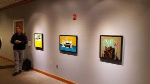 In October 2016, Fidalis discusses some of the paintings he displayed at Rutgers and BYU; the paintings' fishing-lure-inspired titles, from left to right: White Cloud Caution Flasher, Splash Wicked Curse Water, and Lucky Rooster Needle Popper